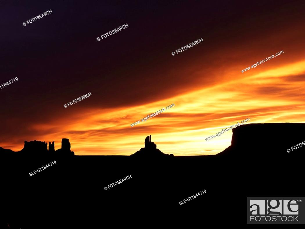 Stock Photo: Scenic sunset landscape of mesas in Monument Valley near the border of Arizona and Utah, United States.