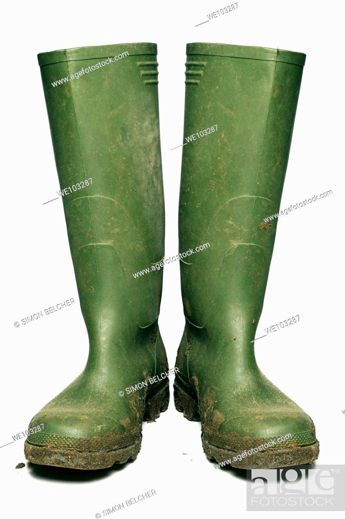 Stock Photo: Wellington Boots Covered in Mud, Cut Out.