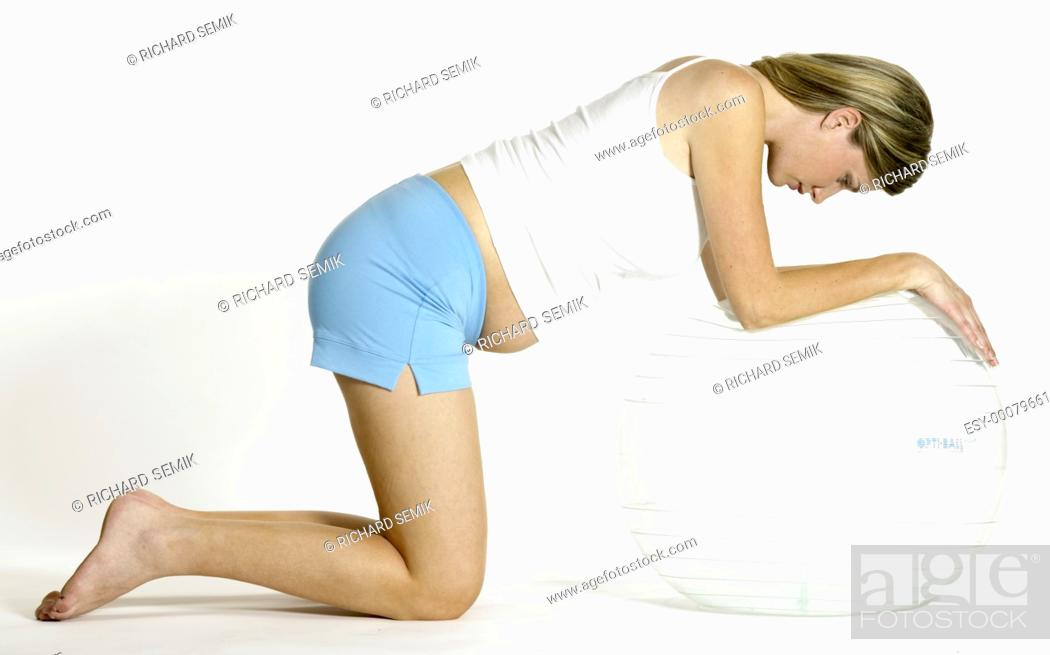 Stock Photo: pregnat woman doing exercises.