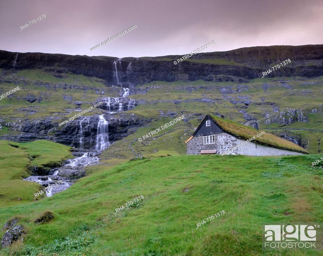 Stock Photo: Traditional turf roofed farm building and waterfall, Saksun, Streymoy Island, Faroe Islands Faroes, Denmark, Europe.
