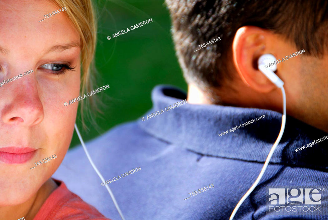 Stock Photo: male and female listening to music together.