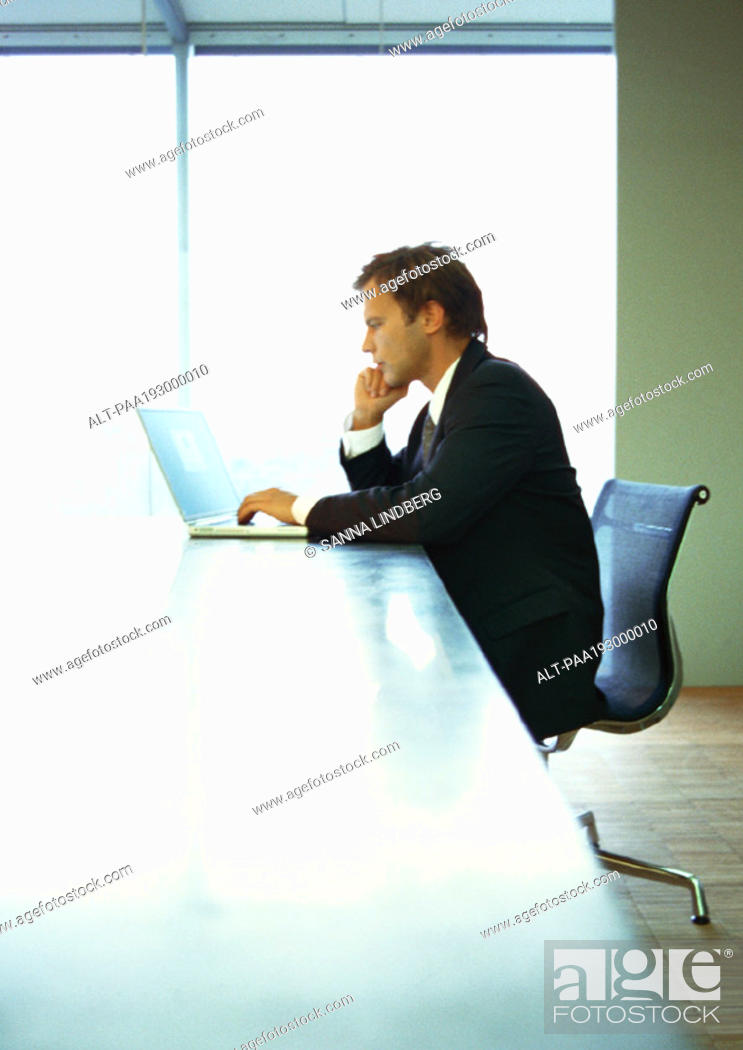 Stock Photo: Businessman working on computer.