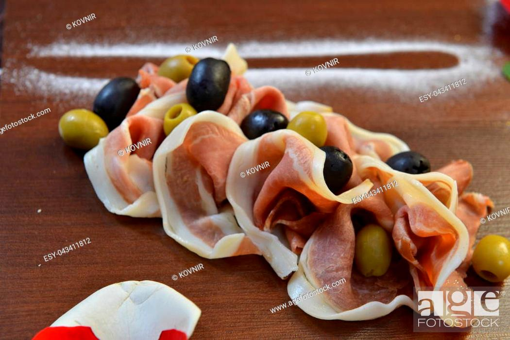 Stock Photo: Salad of cold cuts with olive, salami, parma ham and cheeses.