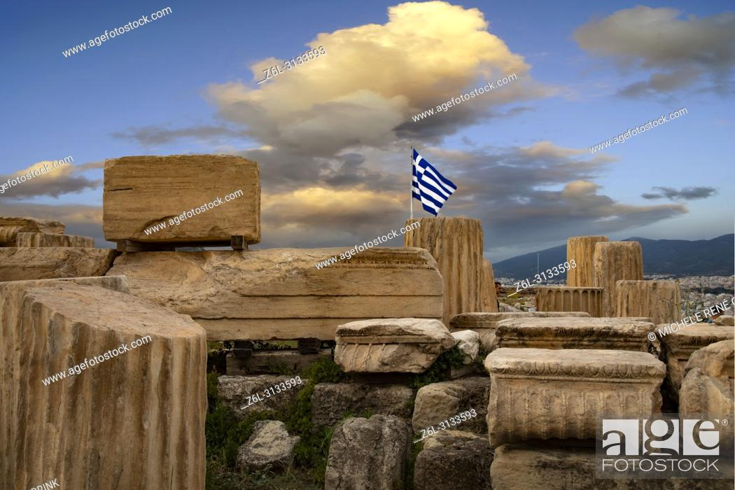 Stock Photo: Ruins with Greek Flag flying located at The Parthenon or Temple of Athena on Athenian Acropolis in Greece.