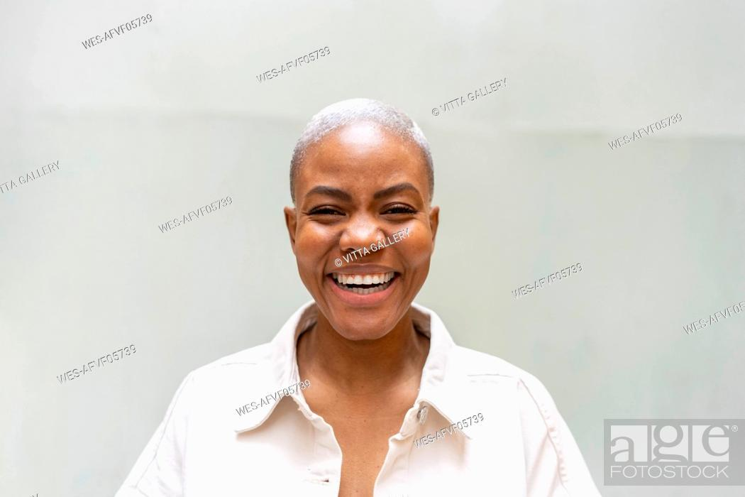 Stock Photo: Portrait of laughing woman outdoors.