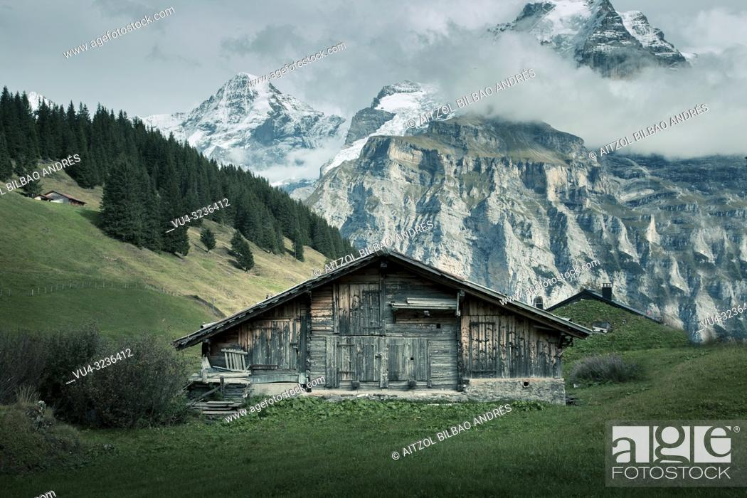 Stock Photo: Lauterbrunnen is situated in one of the most impressive trough valleys in the Alps, between gigantic rock faces and mountain peaks.