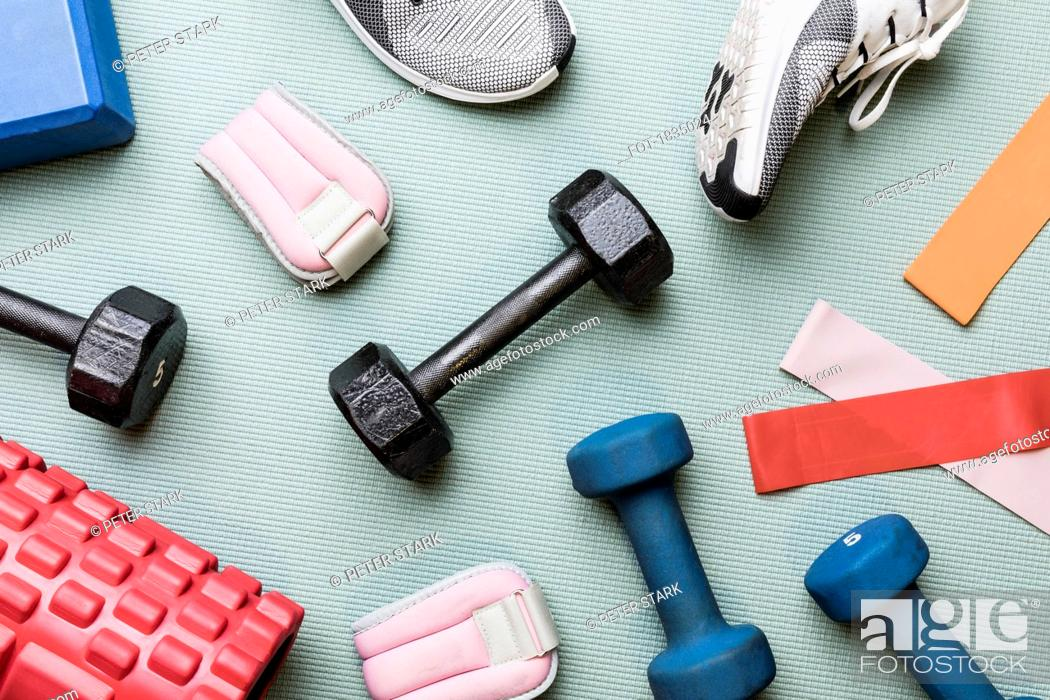 Stock Photo: View from above dumbbells and exercise equipment - knolling.