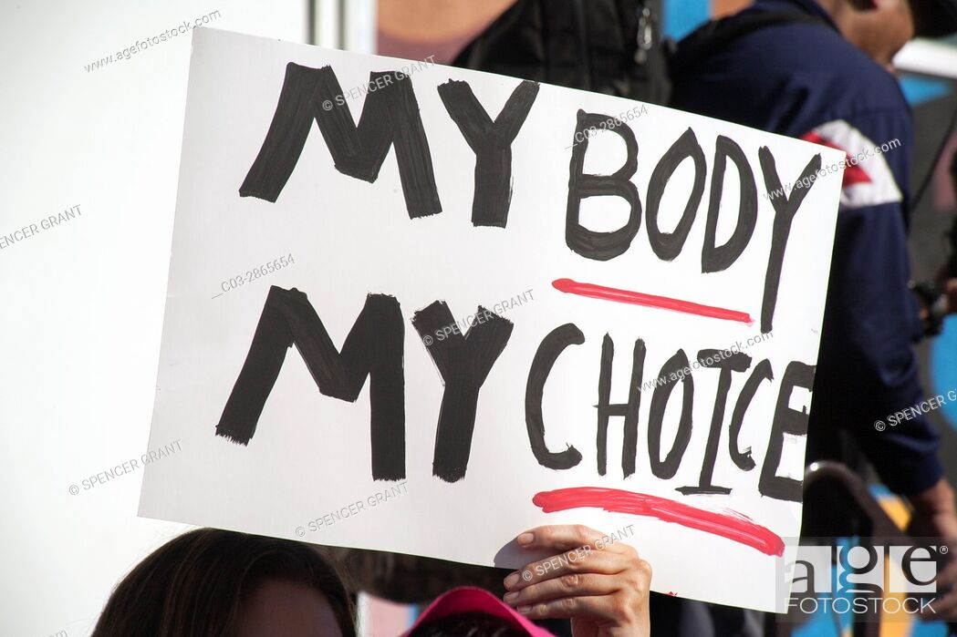 Stock Photo: Signs relating to women's health were common at the January, 2017 Anti-Trump Women's March in Santa Ana, CA.