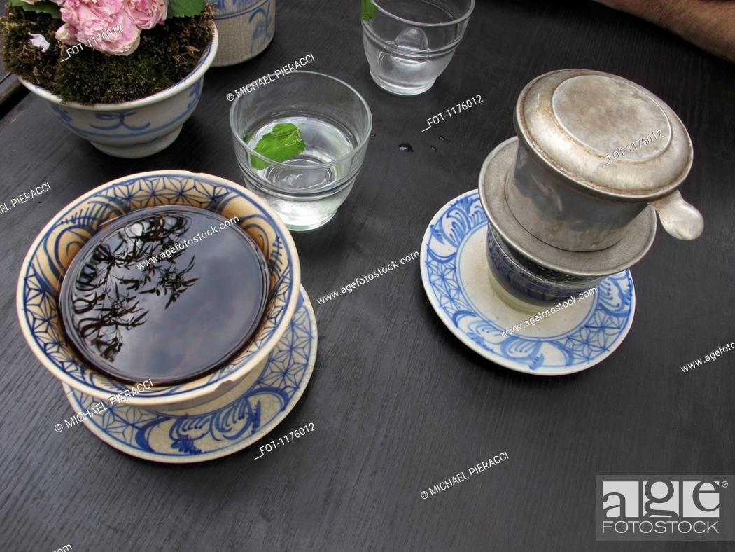 Stock Photo: Reflection of leaves in tea.