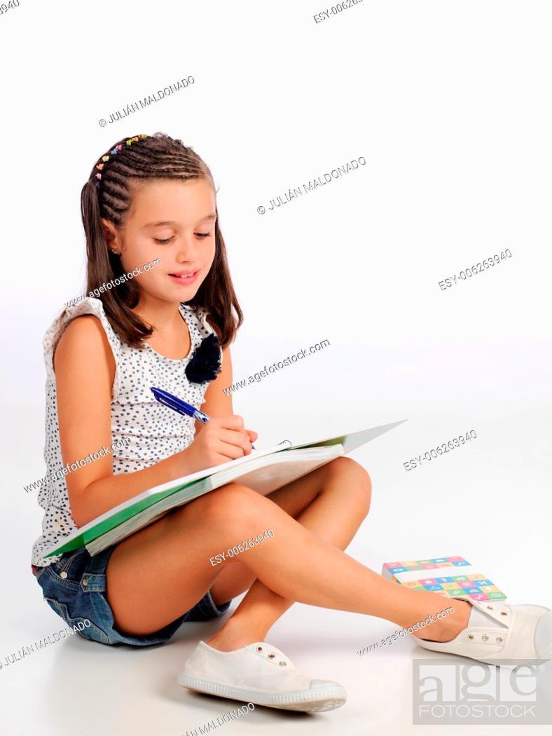Stock Photo: Little girl studying.