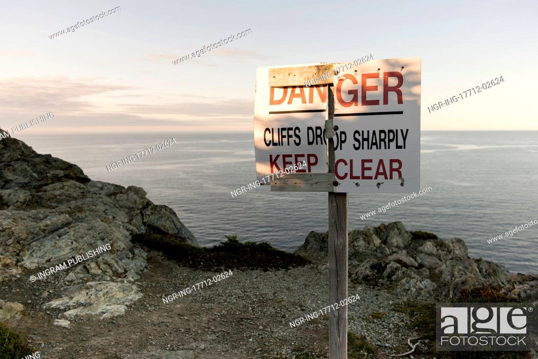 Stock Photo: Warning signboard at coast, Long Point Hiking Trail, Crow Head, Twillingate, North Twillingate Island, Newfoundland And Labrador, Canada.