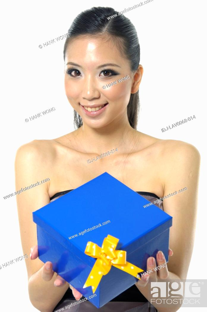 Stock Photo: Woman holding a gift box.