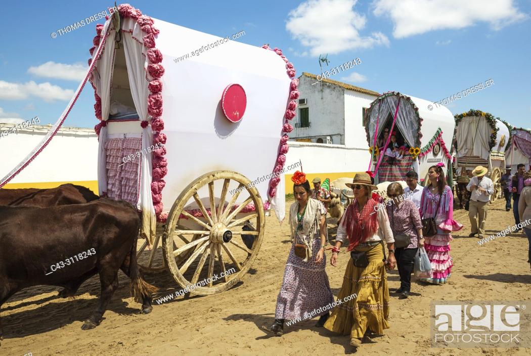 Stock Photo: During a famous Pentecost pilgrimage the village of El Rocio converts into a colourful spectacle with beautifully decorated ox-carts.