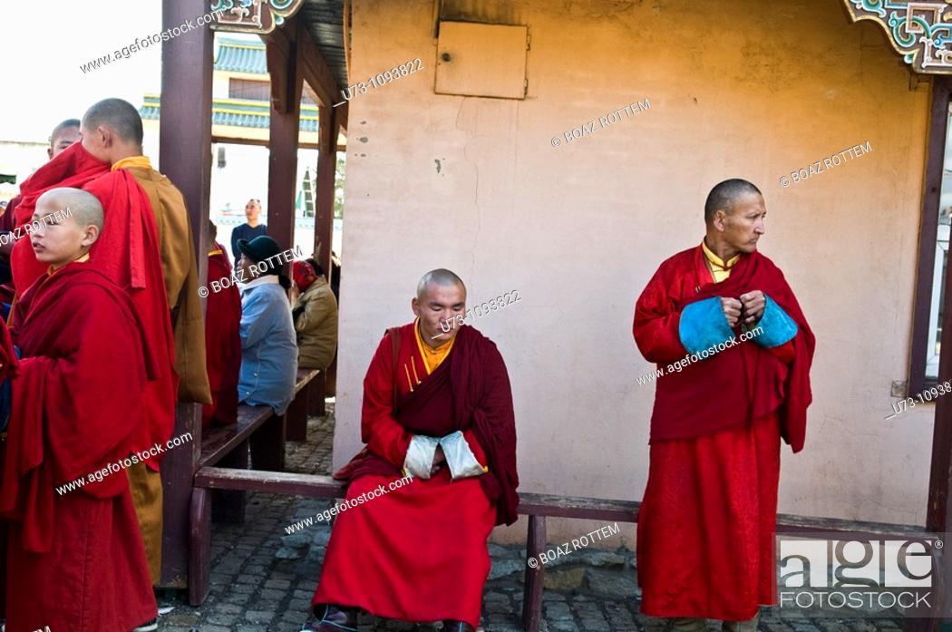 Stock Photo: Mongolian buddhist monks gather in the Ganhan Khiid Buddhist temple in Ulan bator.
