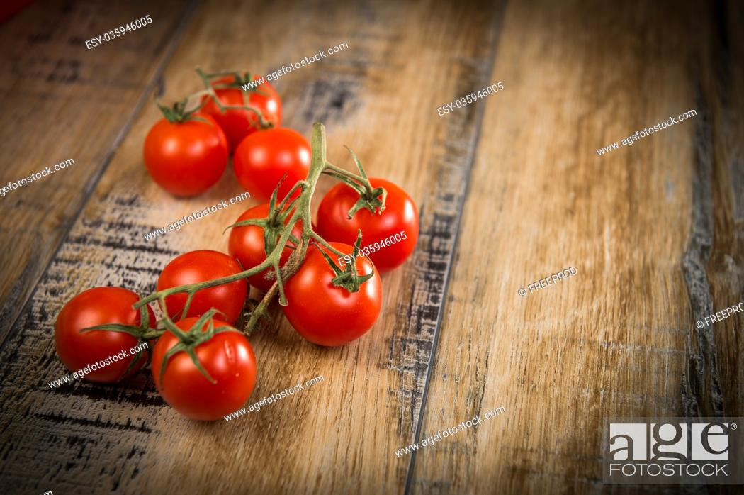 Stock Photo: Fresh cherry tomatoes on wooden background, France.