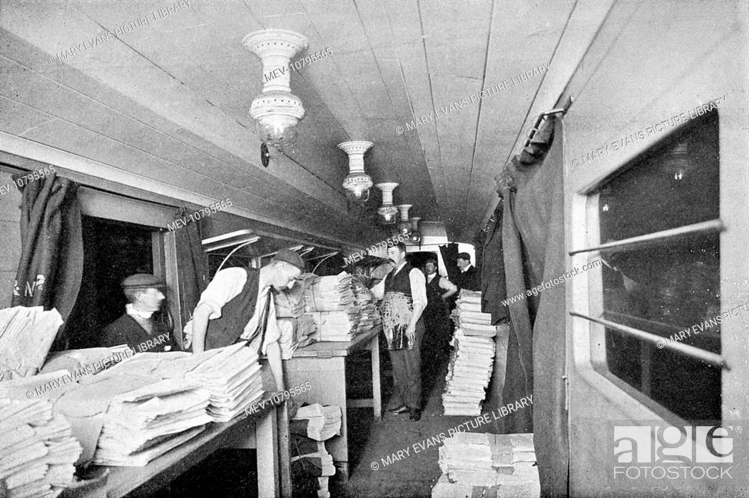 Stock Photo: London newspapers being sorted and packed in transit on board an express train in specially constructed cars, during the night journey.