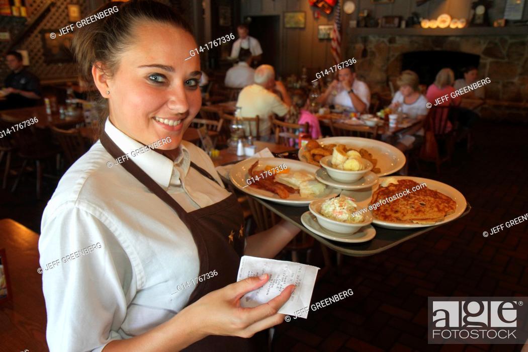 Stock Photo: Florida, Stuart, Cracker Barrel Restaurant, interior, woman, waitress, job, serving, tray, food, plates, pancake,.