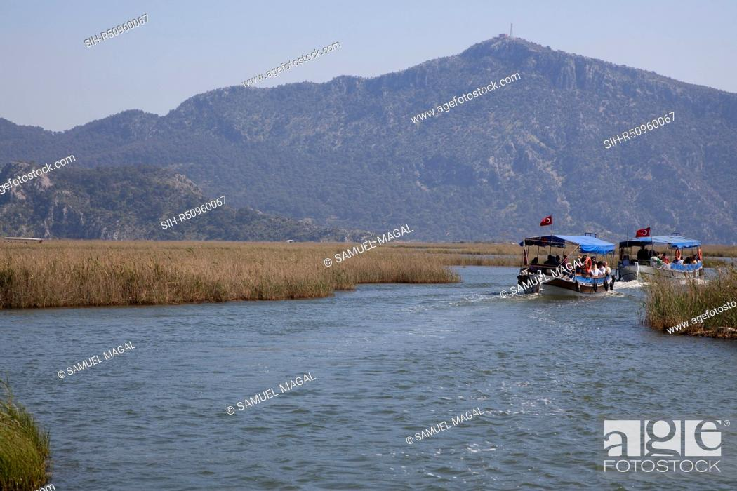 Stock Photo: The Dalyan River flows from the fresh water large Koycegiz Lake in the north to the Mediterranean Sea in the south, passing through the large town of Koycegiz.