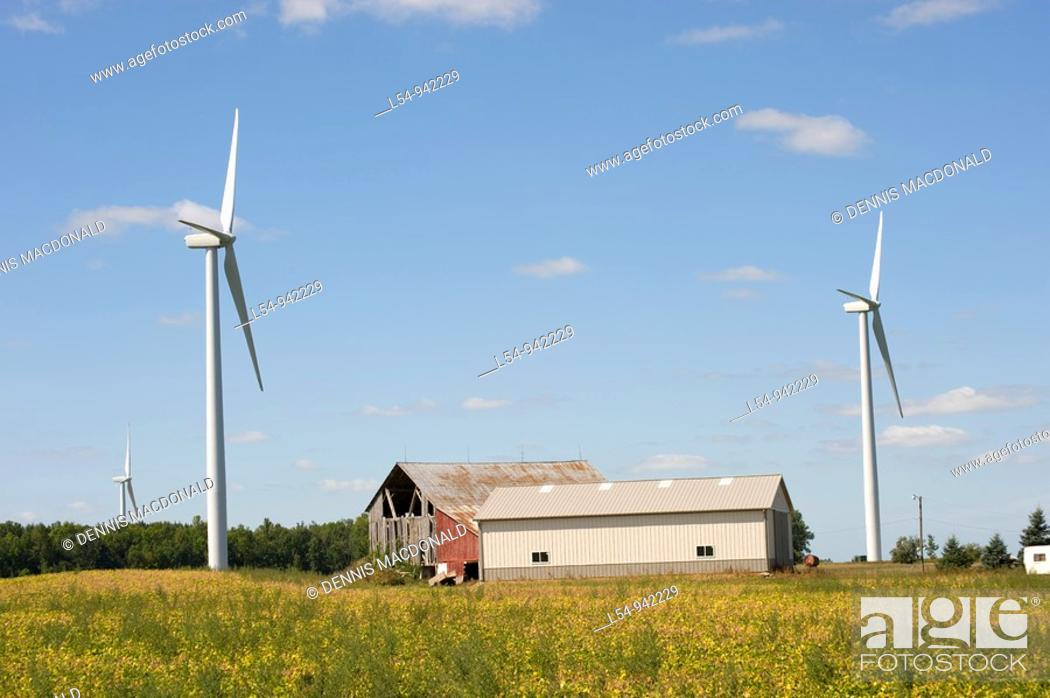 Stock Photo: Agricultural Wind Farm farms turbine produces kinetic energy in wind into mechanical energy converting wind to electricity in Michigan near Ubly Michigan.