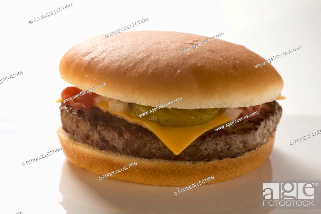 Stock Photo: Cheeseburger with gherkin, onions and ketchup.