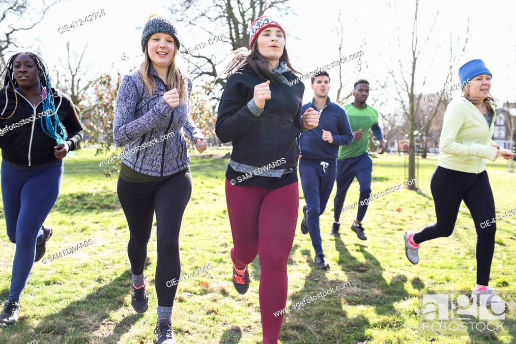Stock Photo: Runners running sunny park.