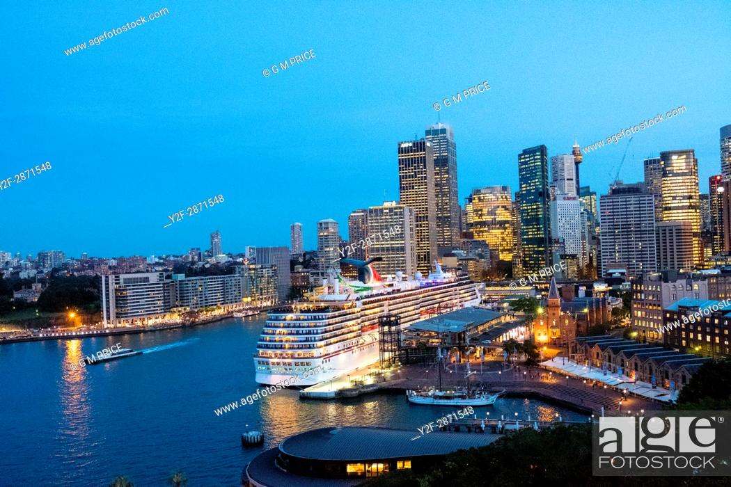 Stock Photo: Sydney city skyline and berthed cruise ship.