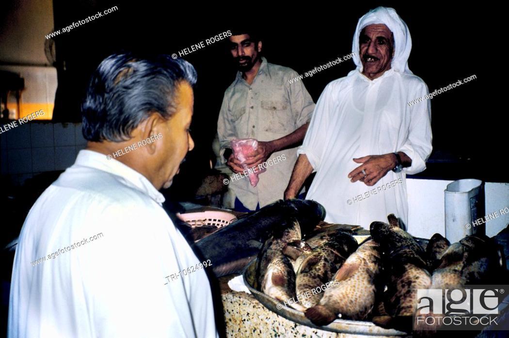 Manama Bahrain Men Talking At Fish Market, Stock Photo