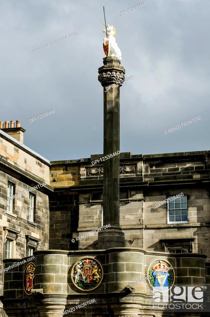 Stock Photo: Mercat Cross with the Royal Unicorn looking across the Royal Mile; Edinburgh, Scotland.