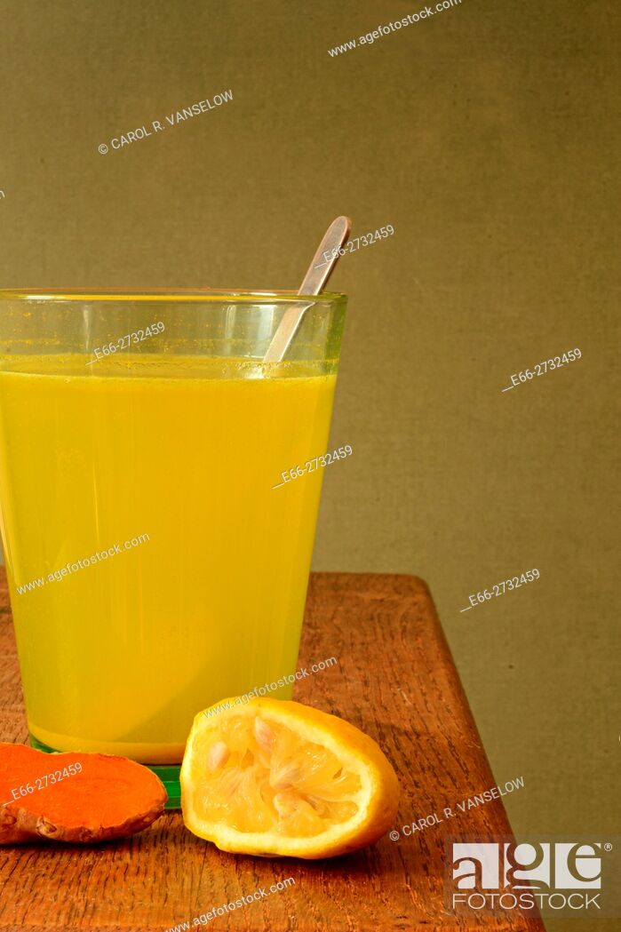 Stock Photo: Morning elixir - lemonade with turmeric. Helps to elimnate toxins from the body.