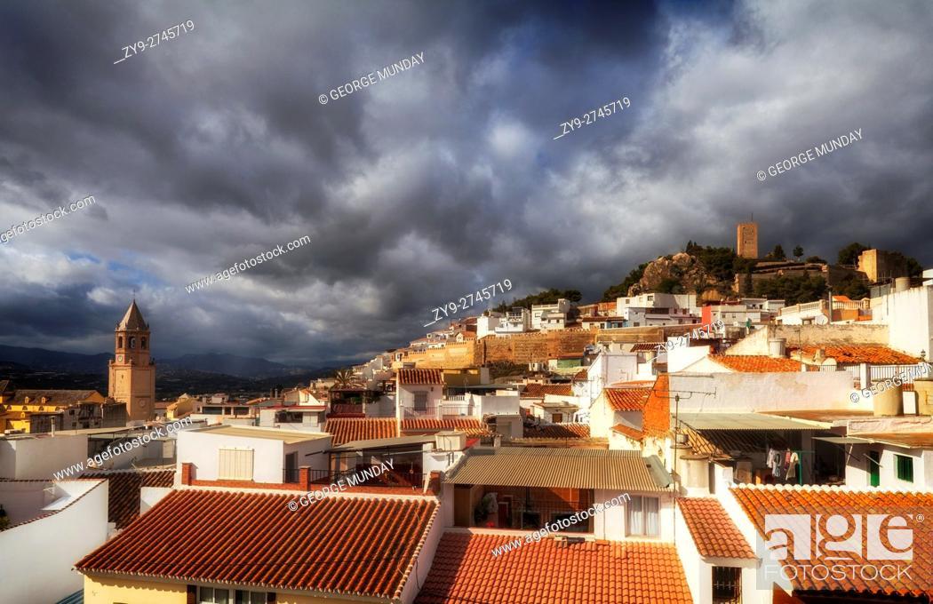 Stock Photo: Church of St. John the Baptist and the 13th Century Moorish Castle tower ,over the rooftops, . Vélez-Málaga, the capital of the Axarquía comarca in the province.