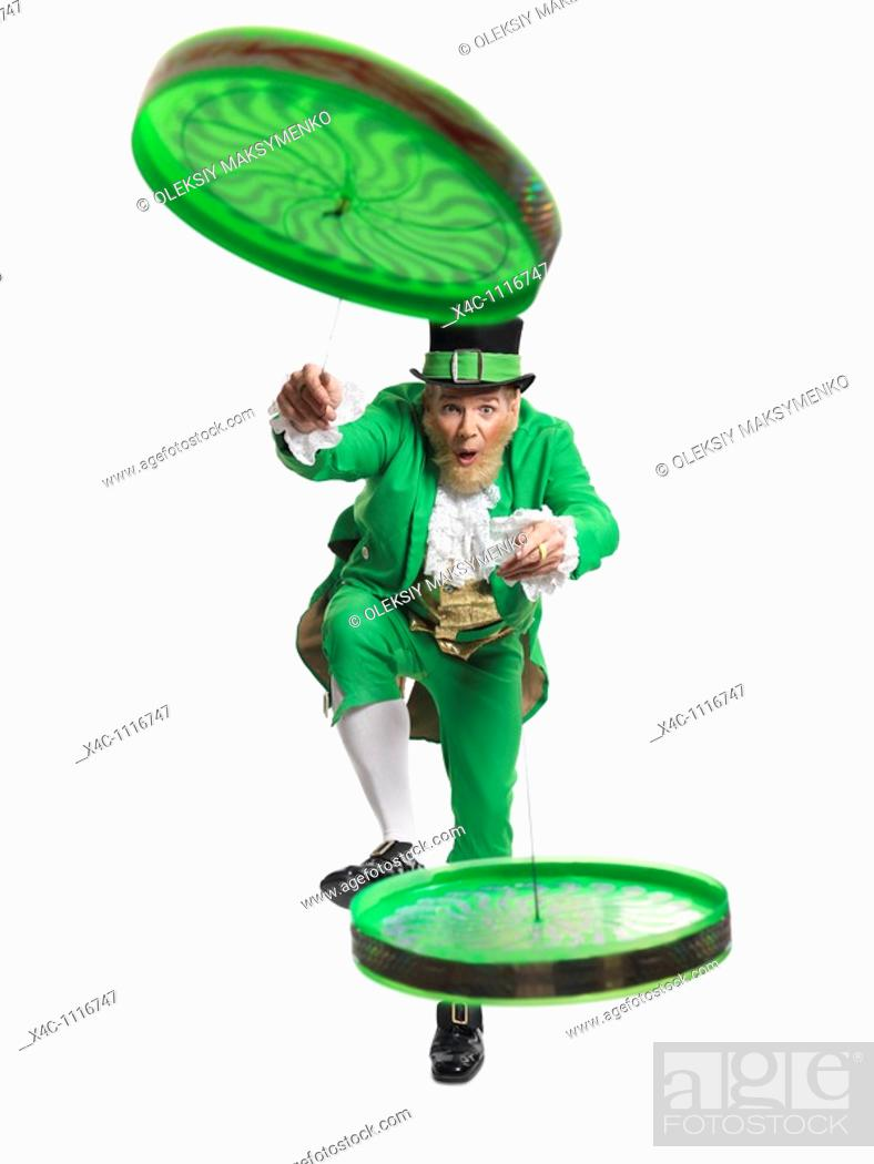Stock Photo: Cheerful Leprechaun playing with two flip n flyers isolated on white background.