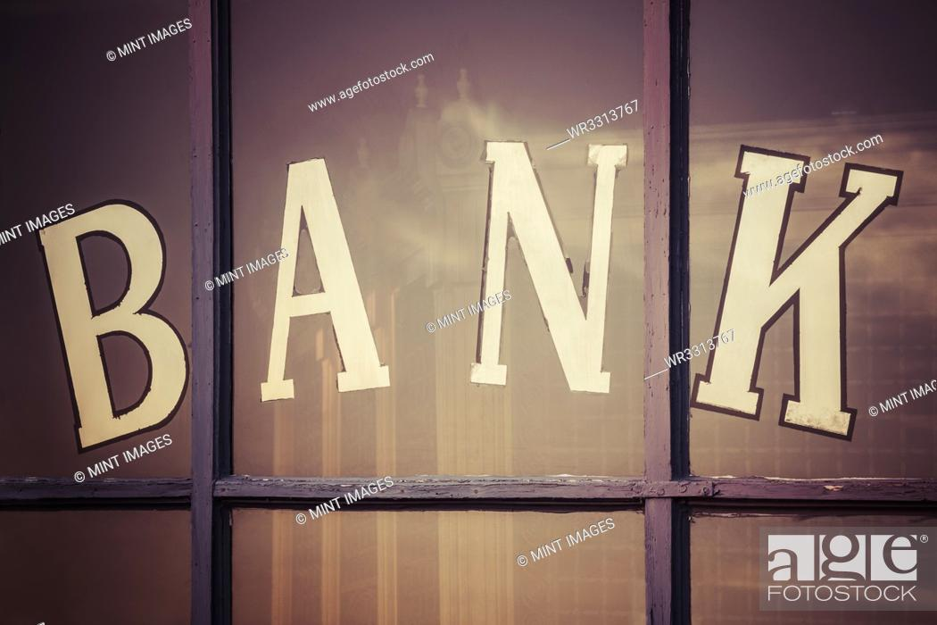 "Stock Photo: Close up of """"bank"""" written on window panes."