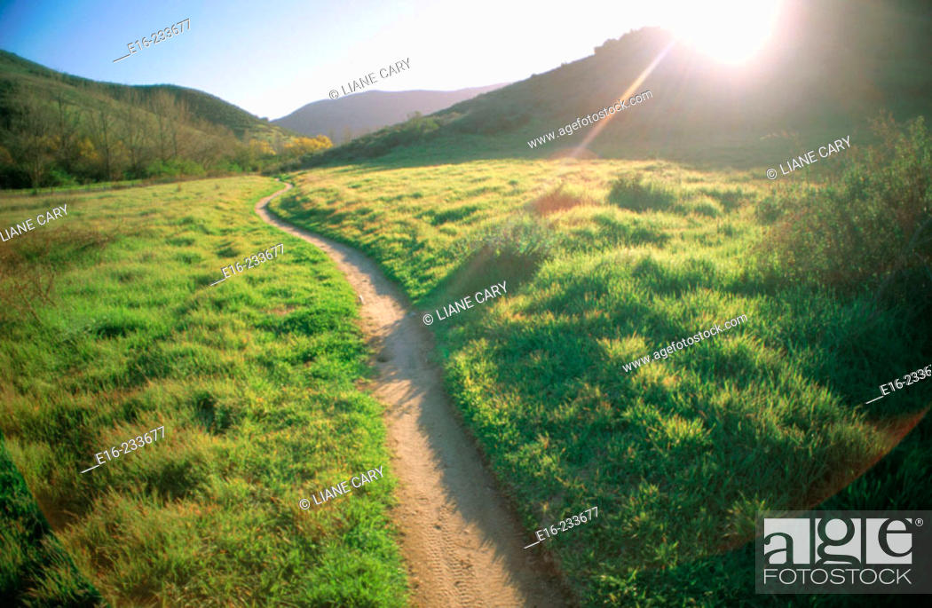 Stock Photo: Sunset path through the hills.