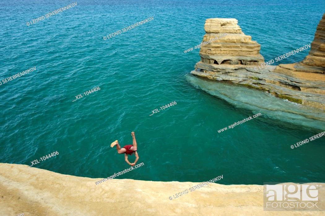 Stock Photo: Cliff diving near Sidari village  Corfu, Greece.