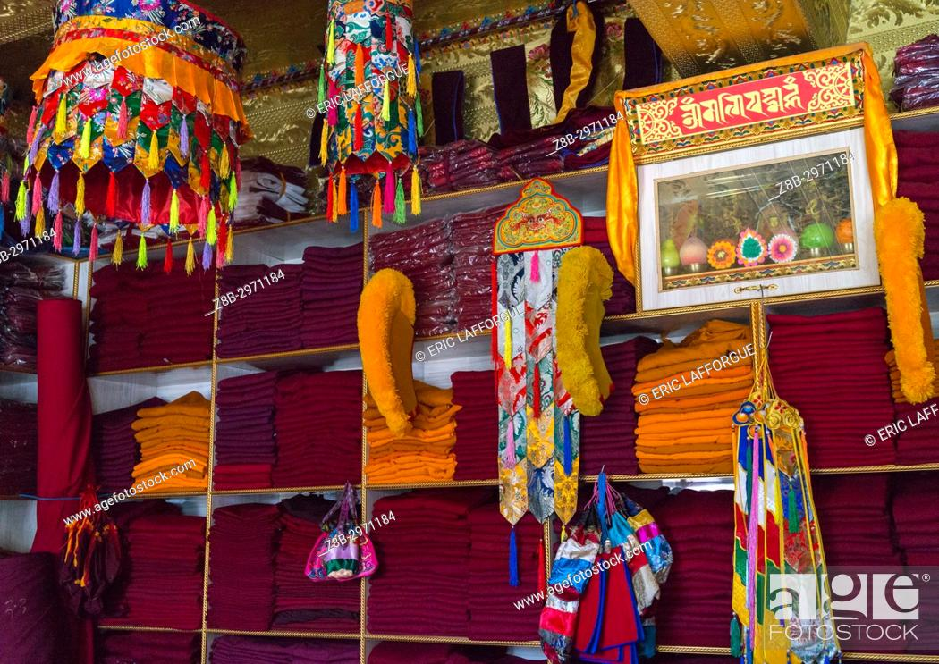 Stock Photo: Tibetan shop selling robes and hats for the monks near Rongwo monastery, Tongren County, Longwu, China.