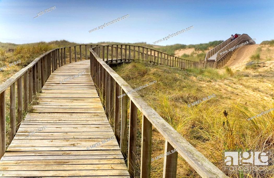 Stock Photo: Wooden footbridge in sand dunes, Dunas de Liencres Natural Park, Cantabria, Spain.