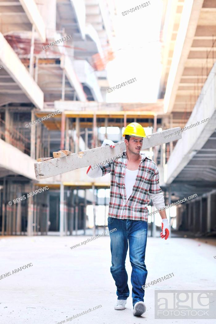 Stock Photo: hard worker on construction site.