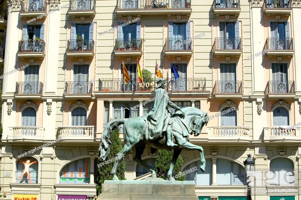 Stock Photo: Statue of man on horse in old section of Barcelona, Spain.
