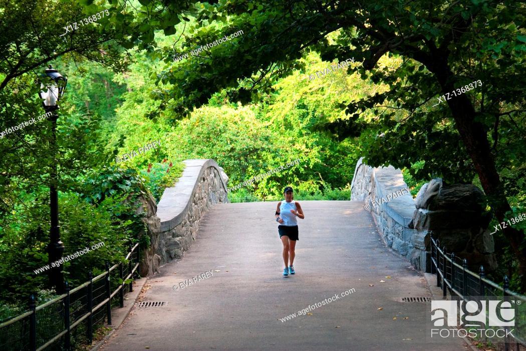 Stock Photo: A sportswoman running in Central Park in Uptown Manhattan New York City.