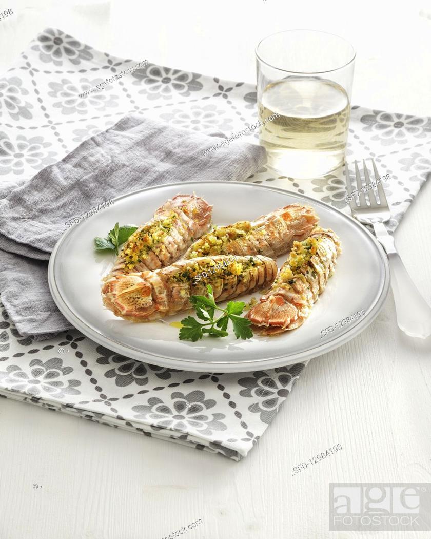 Photo de stock: Gratin mantis shrimps with parsley and garlic crumb filling.