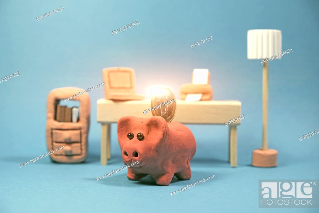 Stock Photo: Clay saving piggy bank with 1 euro coin in office. Finance, budget, savings and investment.