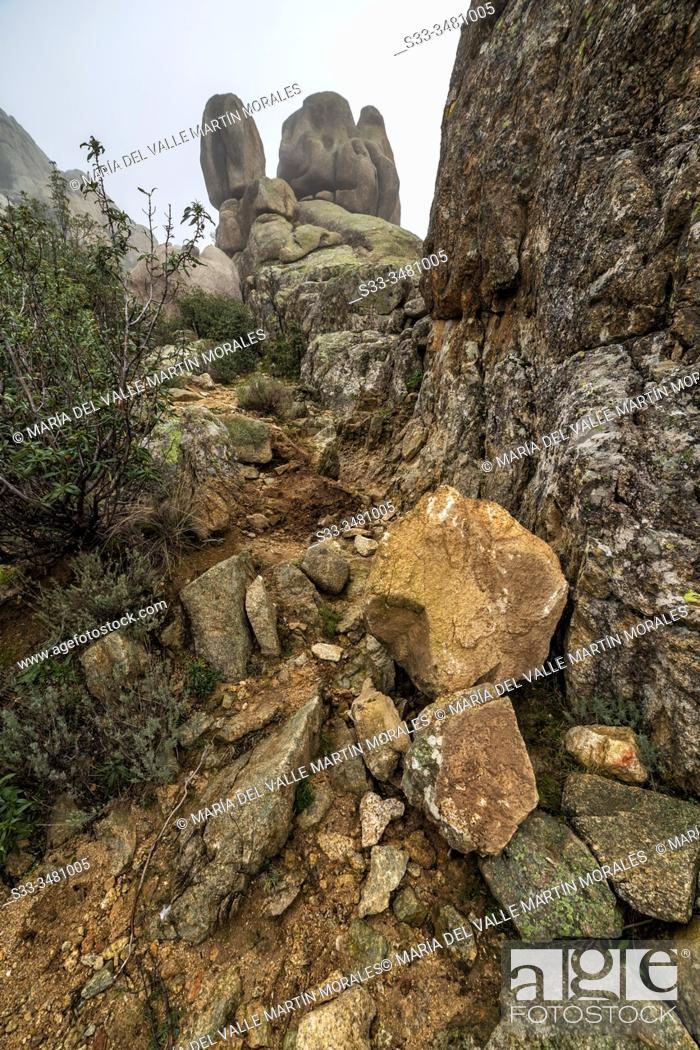 Stock Photo: The Tranco Cliffs at The Coal Miners Path in Pedriza Regional Park, early on a winter morning. Manzanares el Real. Madrid. Spain. Europe.