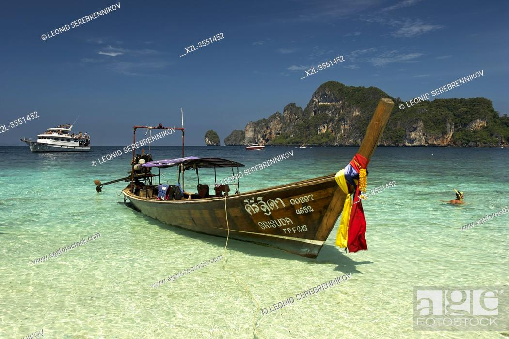 Stock Photo: Traditional long-tail Thai boat moored at the Monkey beach on Phi Phi Don island. Ko Phi Phi archipelago, Thailand.