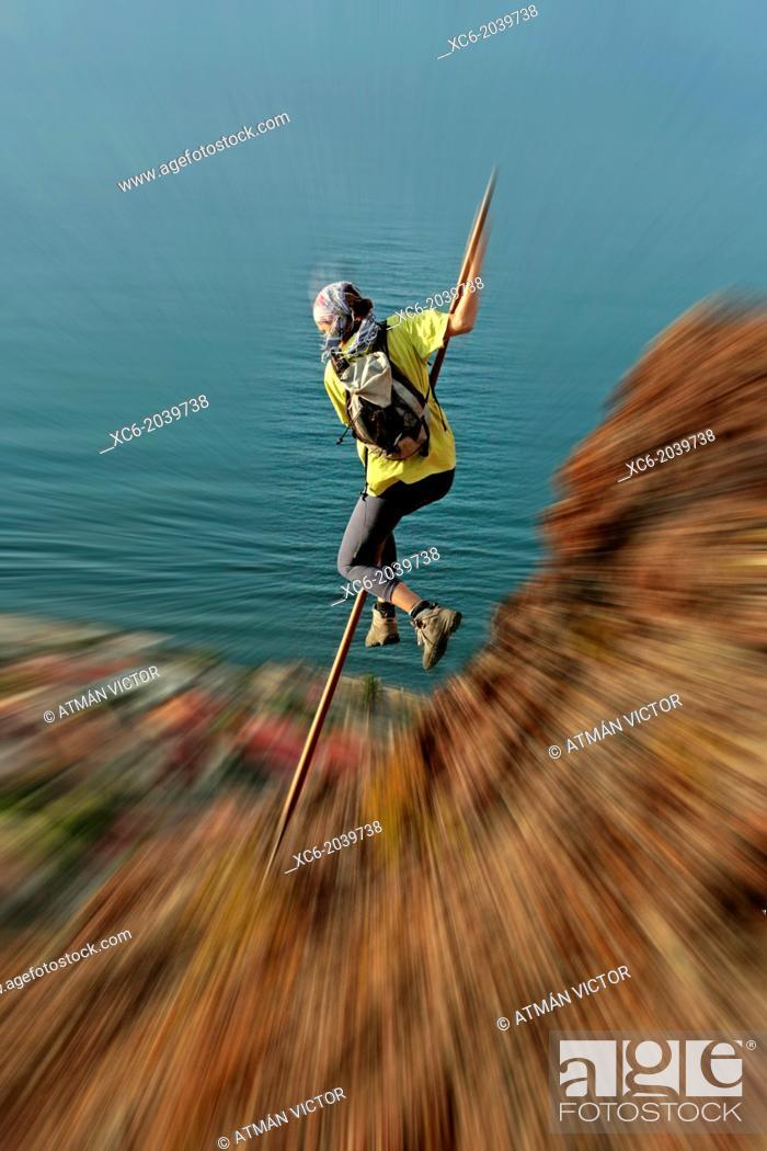 Stock Photo: young woman doing the canarian shepherd jump.