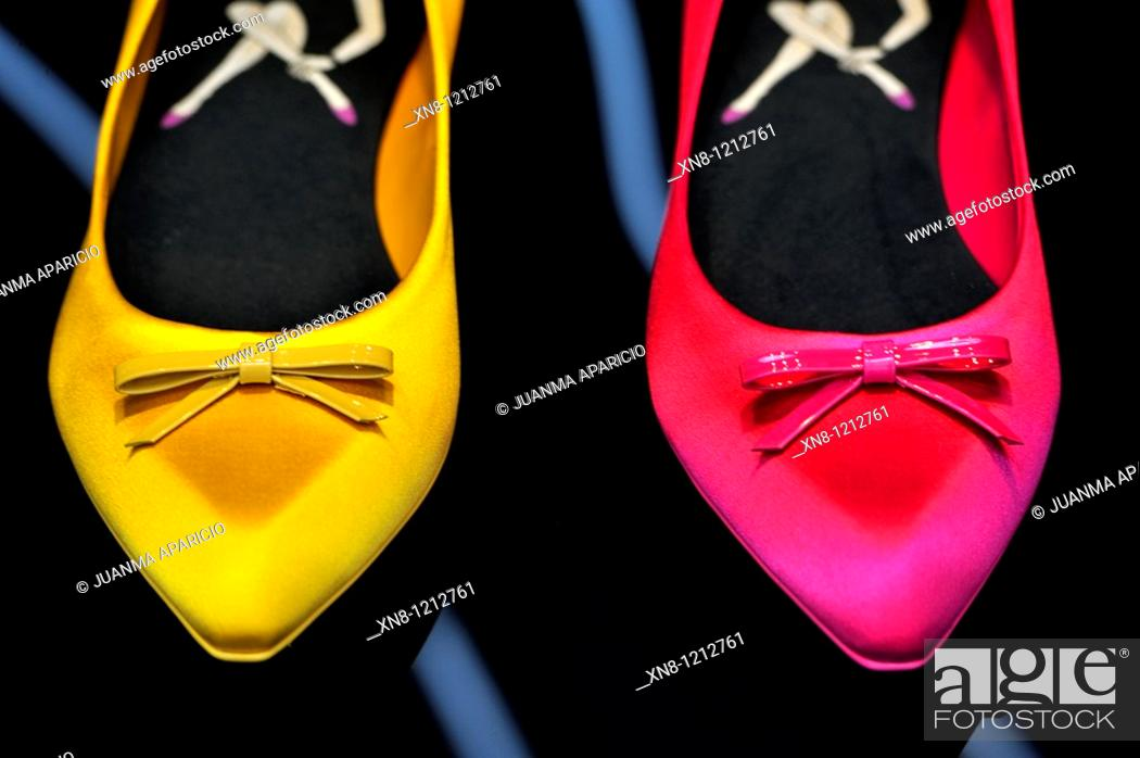 Stock Photo: Yellow and red women shoes on a display.