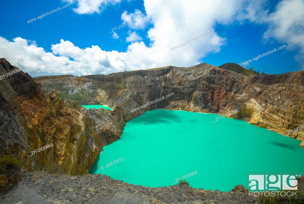 Stock Photo: colourful volcanic lake of kelimutu volcano at flores indonesia.