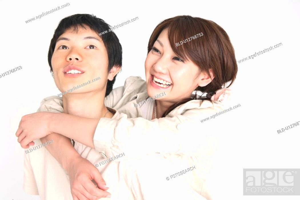 Stock Photo: Woman embracing lover.