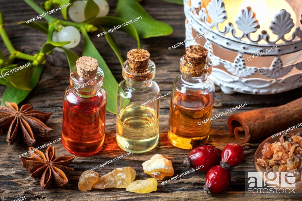 Stock Photo: Christmas collection of essential oils with frankincense, myrrh, cinnamon and mistletoe.