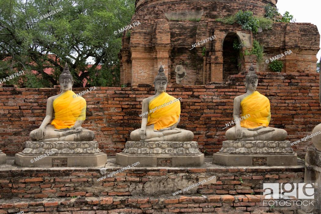 Stock Photo: Ayutthaya Phra Nakhon Si Ayutthaya ancient capital city in Thailand, north of Bangkok. Ruins of Buddhist temples and statues of Buddha decorated with yellow.