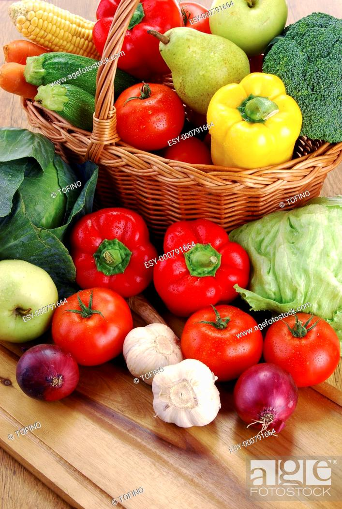 Stock Photo: Composition with raw vegetables and wicker basket.